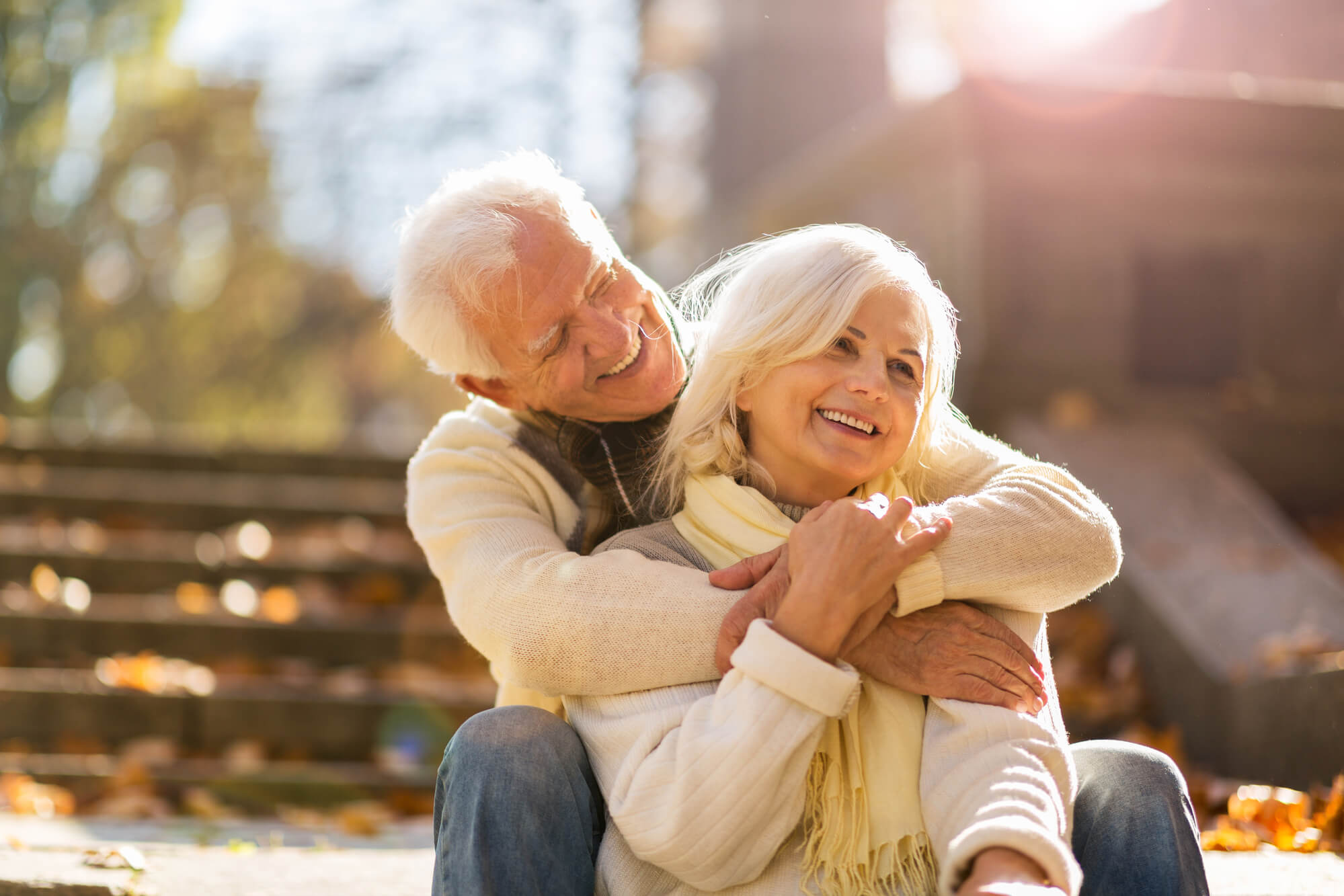 a senior couple smiling contentedly after planning their financial retirement in West Palm Beach