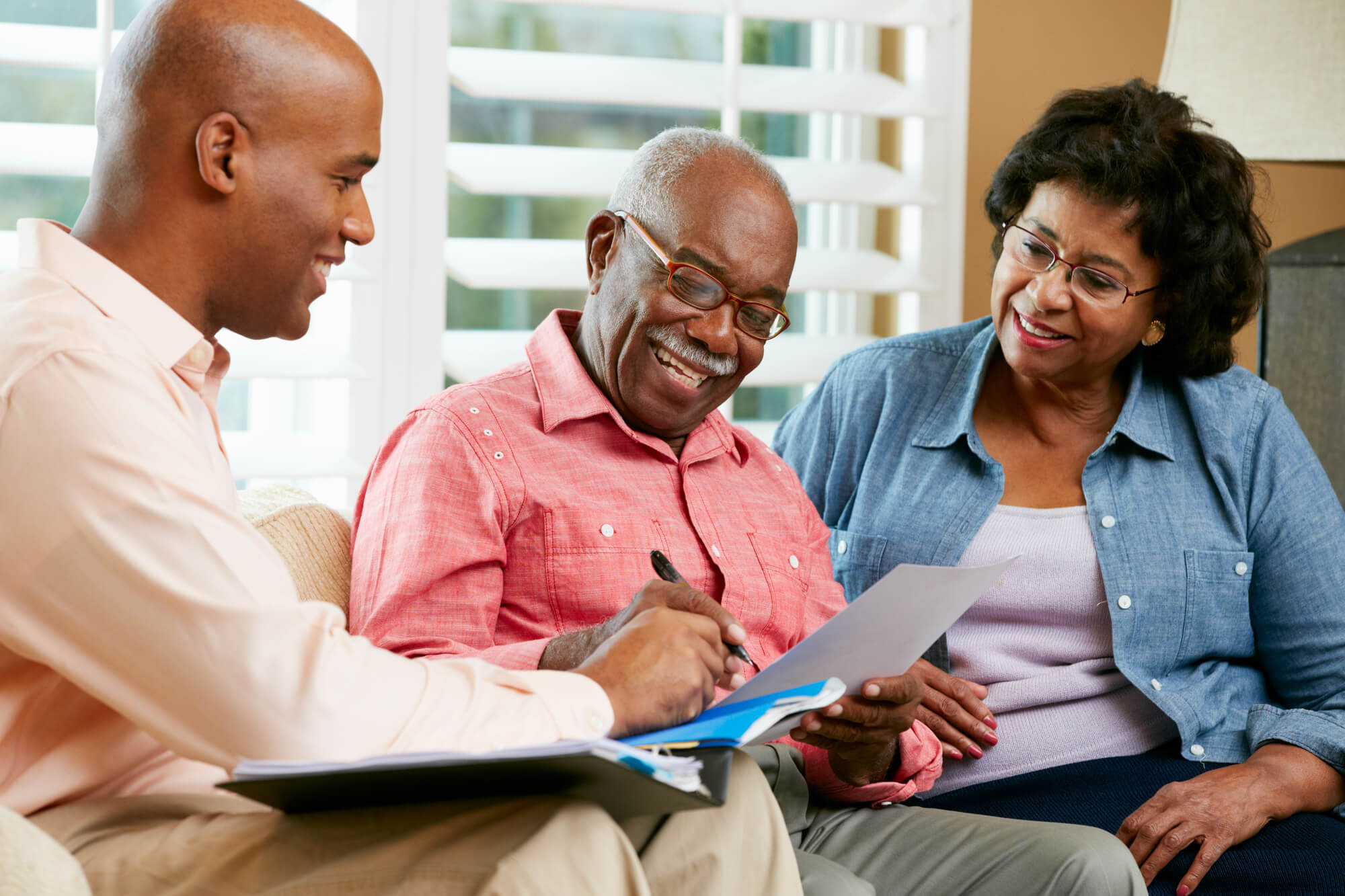 a senior couple planning financial retirement in West Palm Beach with an advisor
