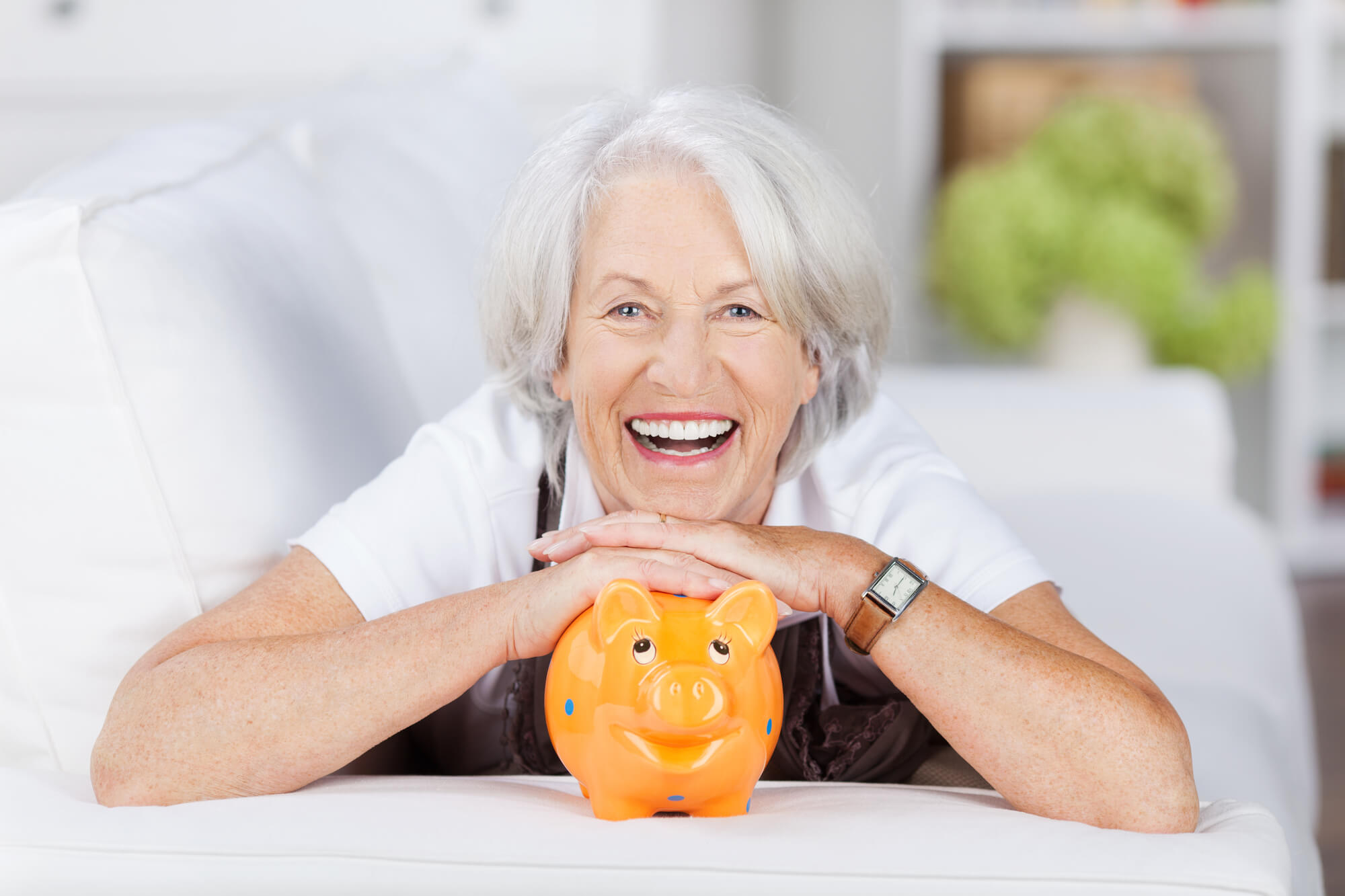 a woman is smiling after successfully planning her financial retirement in West Palm Beach